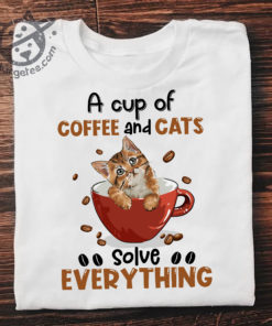 A cup of coffee and cats solve everything